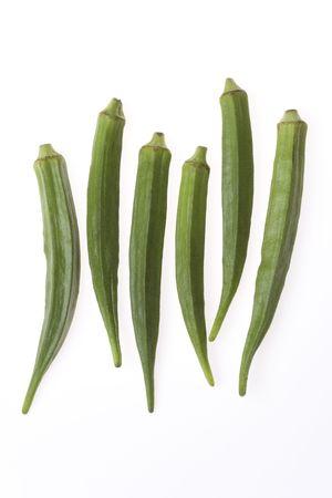 sic: Six Green Fresh Okras On White Background