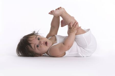pliable: Baby Girl Lying On The Floor With With One Leg Up Like Fitness