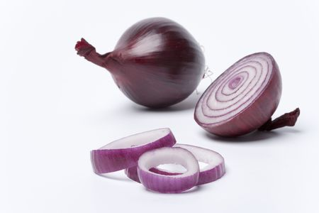 onion rings: One red onion,half and rings on white background