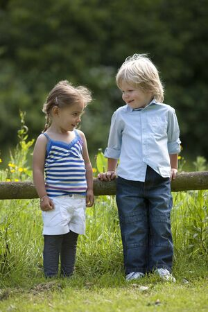 Little Boy And Girl Talking In The Parc Stock Photo - 5434912