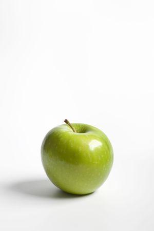 granny smith apple: One single green Granny Smith apple Stock Photo