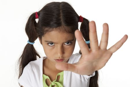 Little girl is makes a stop gesture with her hand photo