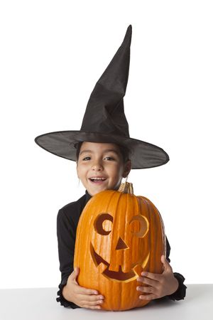Little girl with a Halloween pumpkin  photo