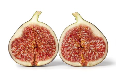 Two half fresh figs on plain background  Stock Photo - 6013673