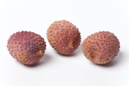 lychees:  Three lychees on white background