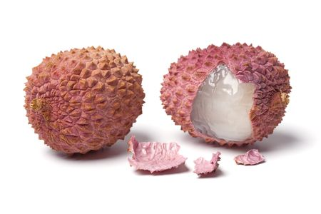 lychees: Two lychees on white background  Stock Photo
