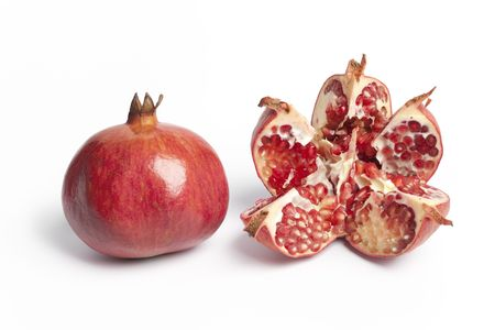 punica granatum: Whole and open Pomegranate, Punica Granatum, on white background