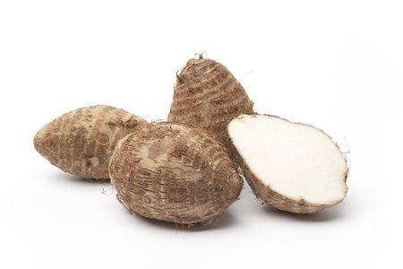 Taro roots on white background