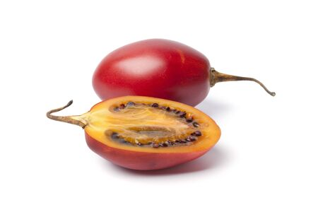 One and a half Tamarillo on white background photo