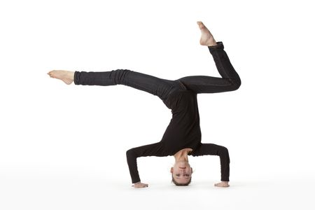 headstand: Teenage girl standing on her head on white background