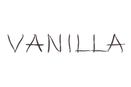 Vanilla beans, Vanilla planifolia in letters on white background Stock Photo - 7379024