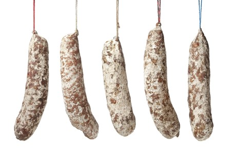 French Sausages hanging on a string on white background