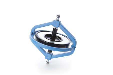 Spinning gyroscope on white background photo