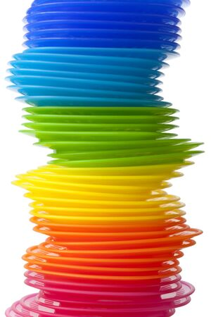 item:  Rainbow colored plastic plates on white background