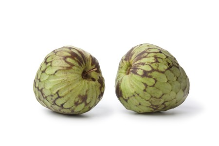 sweetsop: Pair of whole Cherimoya fruit isolated on white background Stock Photo