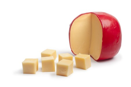 edam:  Dutch Edam cheese cubes on white background