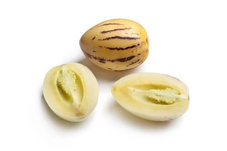 pepino: Whole and half Pepino melons on white background Stock Photo