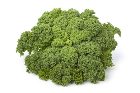 brassica: Curly kale on white background Stock Photo