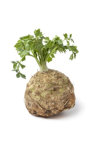 celery root: Fresh celery root and leaves isolated on white background
