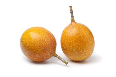 grenadilla:  Whole orange passion fruit isolated on white background