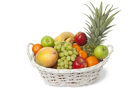 apple basket:  White basket with a variety of fresh fruit on white background