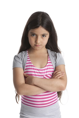 8 years:  Portrait of an eight year old stubborn angry girl on white background