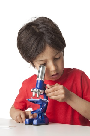 Little boy looking through a microscope on white background Stock Photo - 9637959