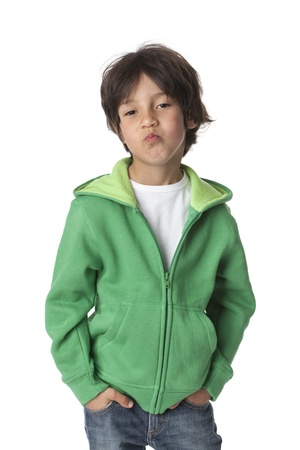 Portrait of a cool little boy on white background photo