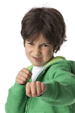 Little boy in fighting position on white background  photo
