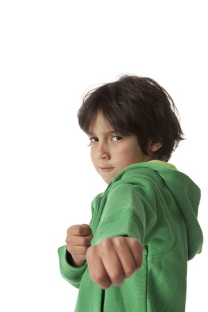 Little boy in fighting positionon white background and negative space for text photo