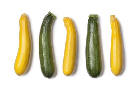 courgettes: Yellow and green courgettes on white background
