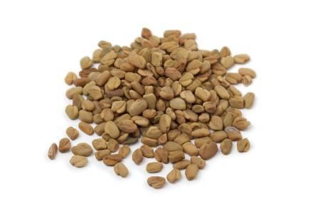 fenugreek: Heap of Fenugreek seeds on white background Stock Photo