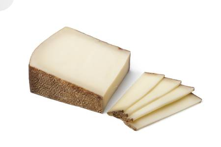 gruyere: Piece of Swiss Gruyere cheese ans slices on white background