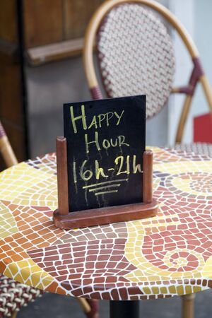 Sign for Happy Hours on a table photo