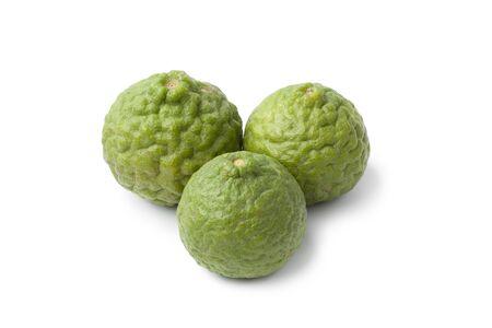 kafir lime: Whole Kaffir limes on white background