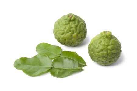 kafir lime:   Kaffir limes and leaves on white background