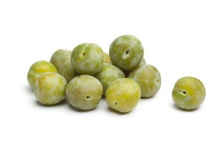 Whole fresh greengage plums on white background