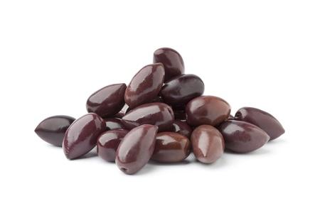Heap of black Calamata olives on white background