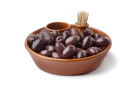 Bowl with black Calamata olives on white background photo