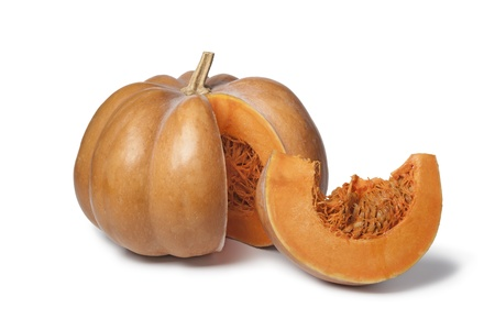 Muscat de Provence pumpkin with a slice on white background
