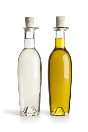 Bottles with oil and vinegar on white background