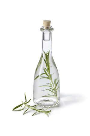 Fles met dragon azijn op witte achtergrond Stockfoto