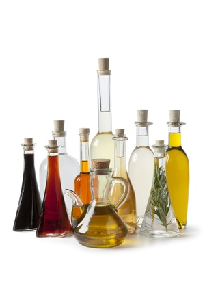 vinegar: Bottles with various  types of oil and vinegar on white background