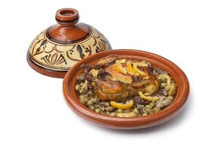 Moroccan dish with chicken and lemon on white background