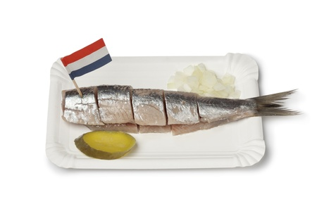 Traditional fresh herring with onions the way it is eaten in Amsterdam, Netherlands on white background Banque d'images