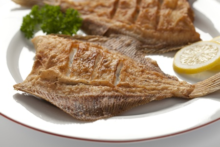 plaice: Dish with fried plaice, lemon and parsley Stock Photo