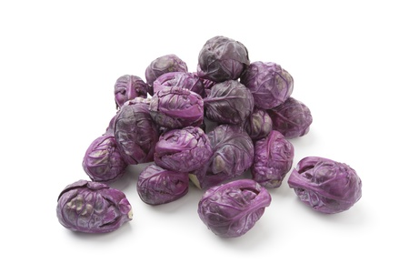 brussels sprouts: Purple Brussels sprouts on white background Stock Photo