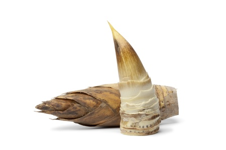 Whole and peeled bamboo shoot on white background Banque d'images