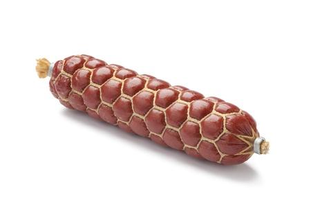 salami sausage: German type of salami sausage on white background Stock Photo
