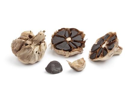 garlic: Black garlic on white background